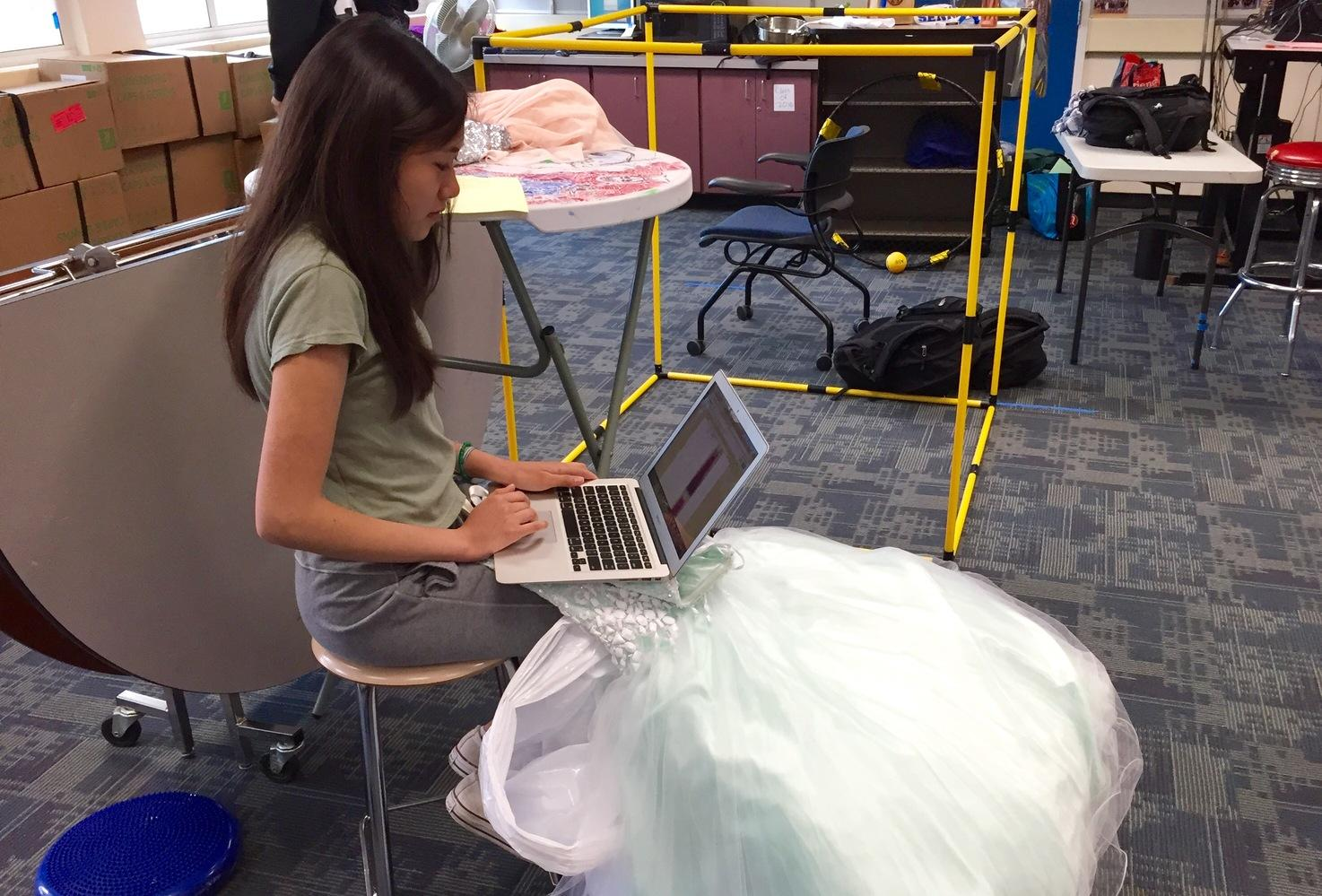 Sophomore and Do Something commissioner in ASB,  Katie Wong catalogues a dress that was donated to Gowns for Girls.