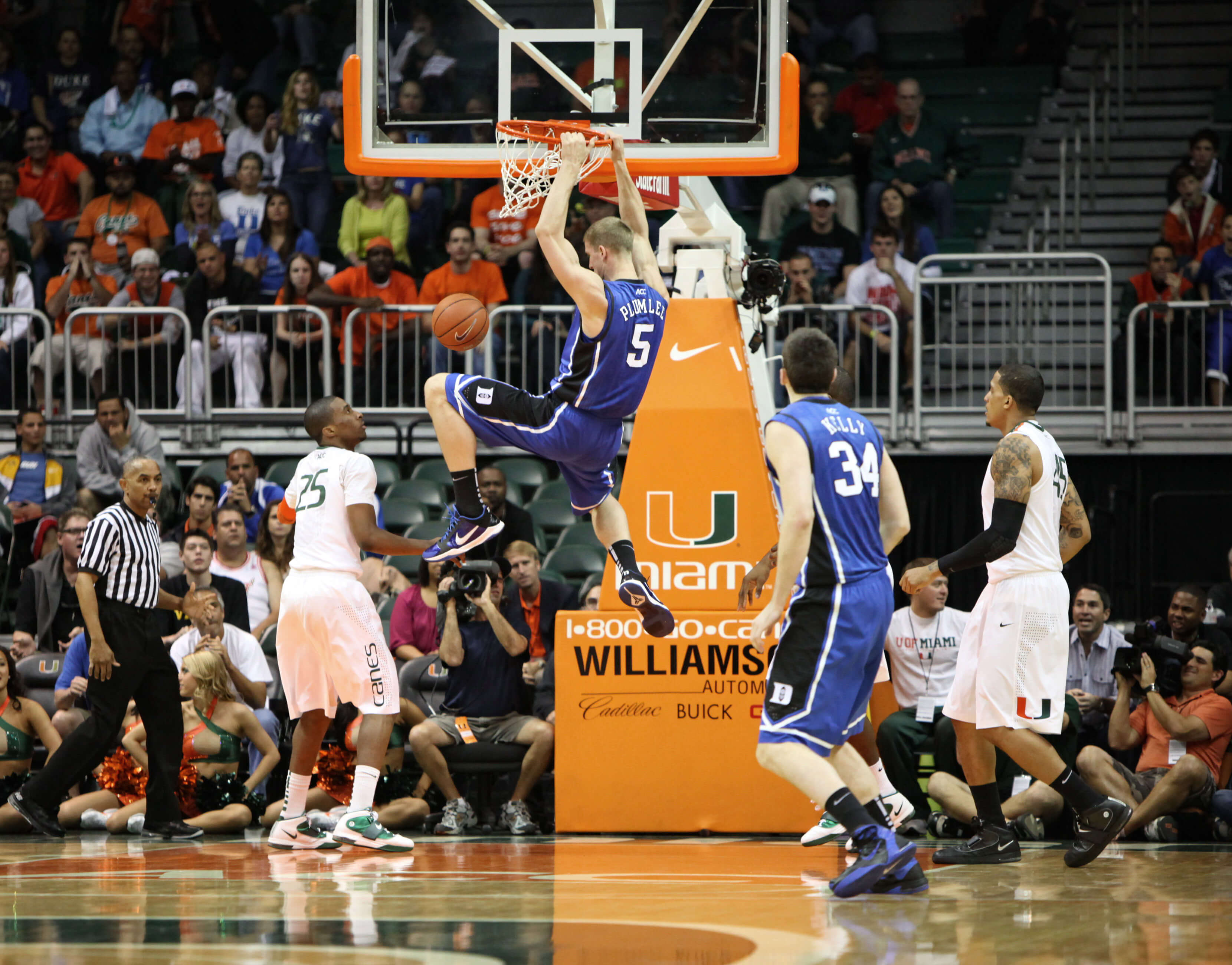 A Duke University player makes a basket during a game against the Miami Hurricanes. One of Duke's opponents was scheduled to play at the university, located in North Carolina. However, the game was canceled due to controversy over the HB2 law.