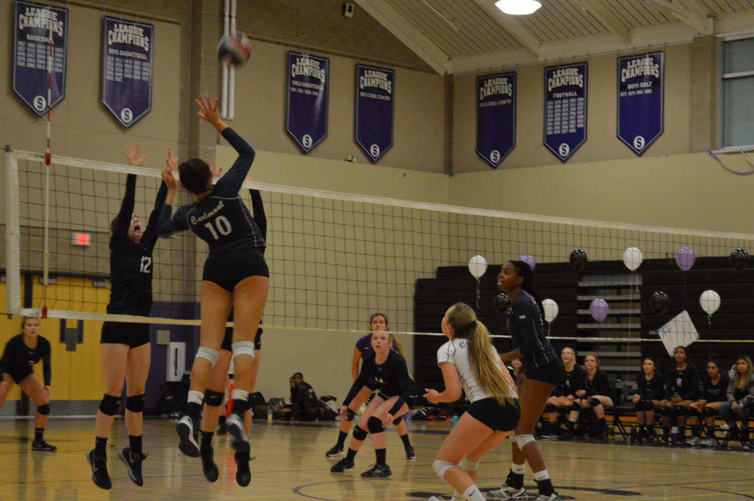 Junior Maya McClellan spikes the ball over the net earning points for the Scots.
