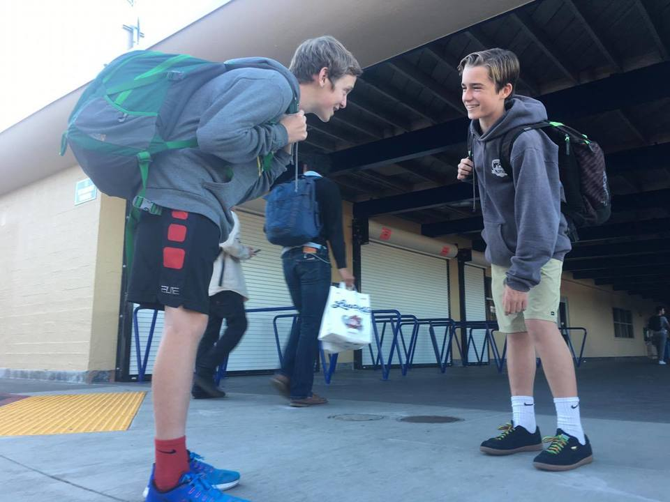 Freshmen Tyler Dartnell and Parker English fill their backpacks with books to study for finals.