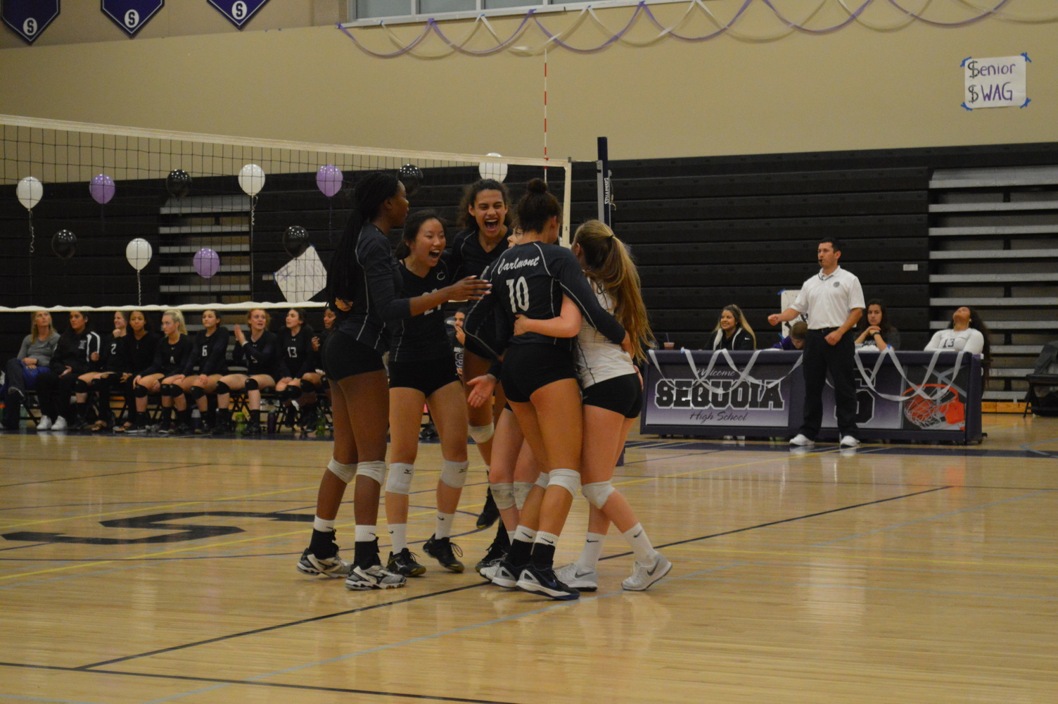 Varsity+volleyball+celebrates+their+final+win+of+the+season+against+the+Cherokees.+