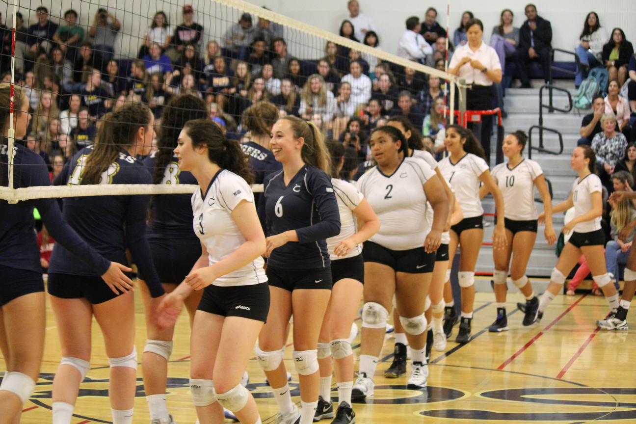 Varsity+Volleyball+displays+sportsmanship+during+the+Battle+of+Belmont.+