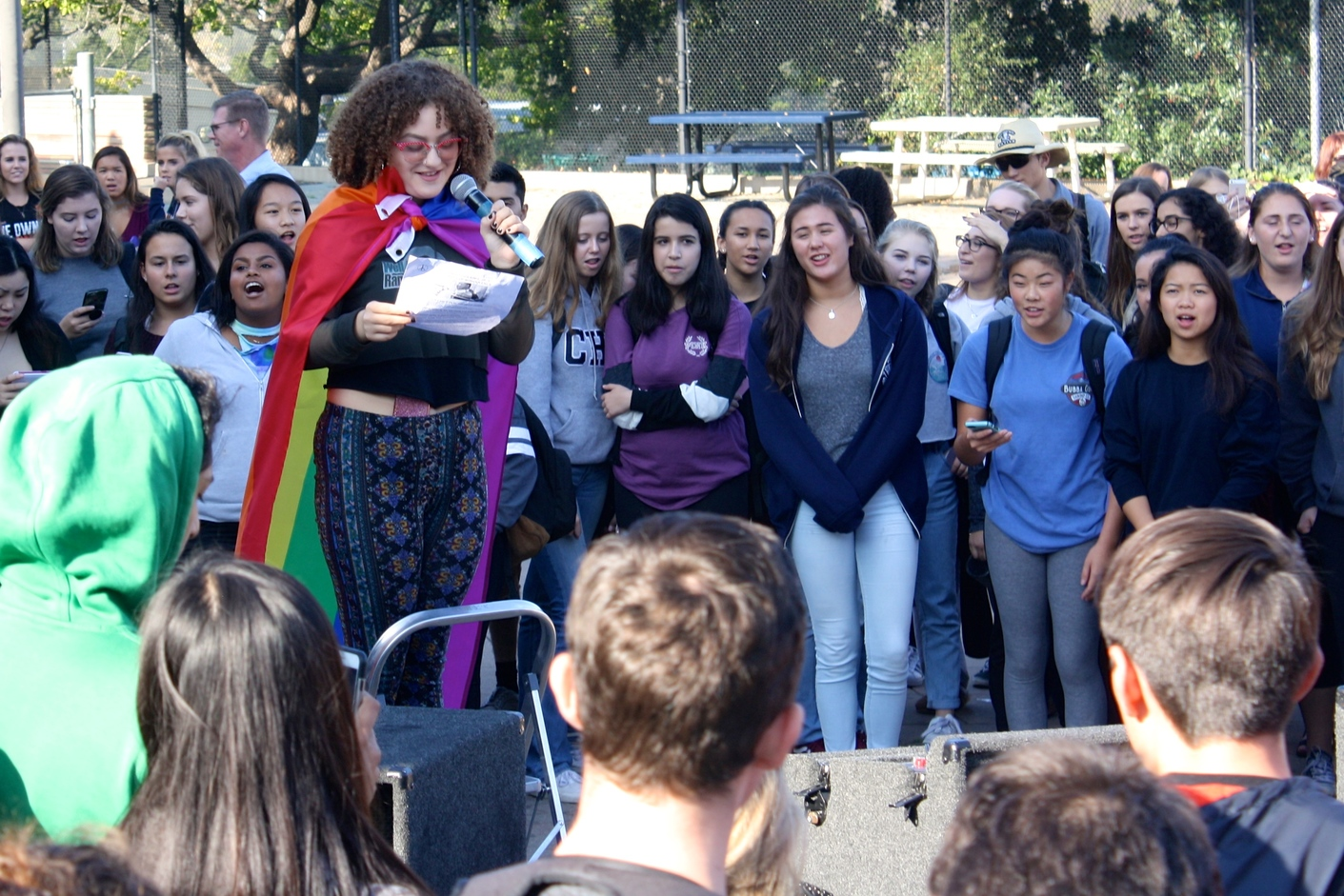 Students crowded around junior Rosie Asmar as she introduced the rally.