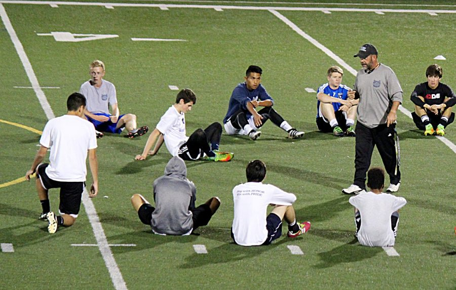 Coach+Stambaugh+gives+his+team+a+pep+talk+before+practice.