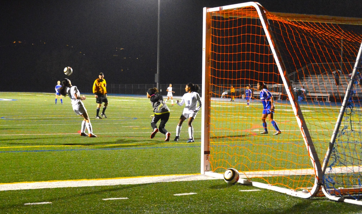 The Panther's goalie runs out of goal in an attempt to save another shot from the Scots.