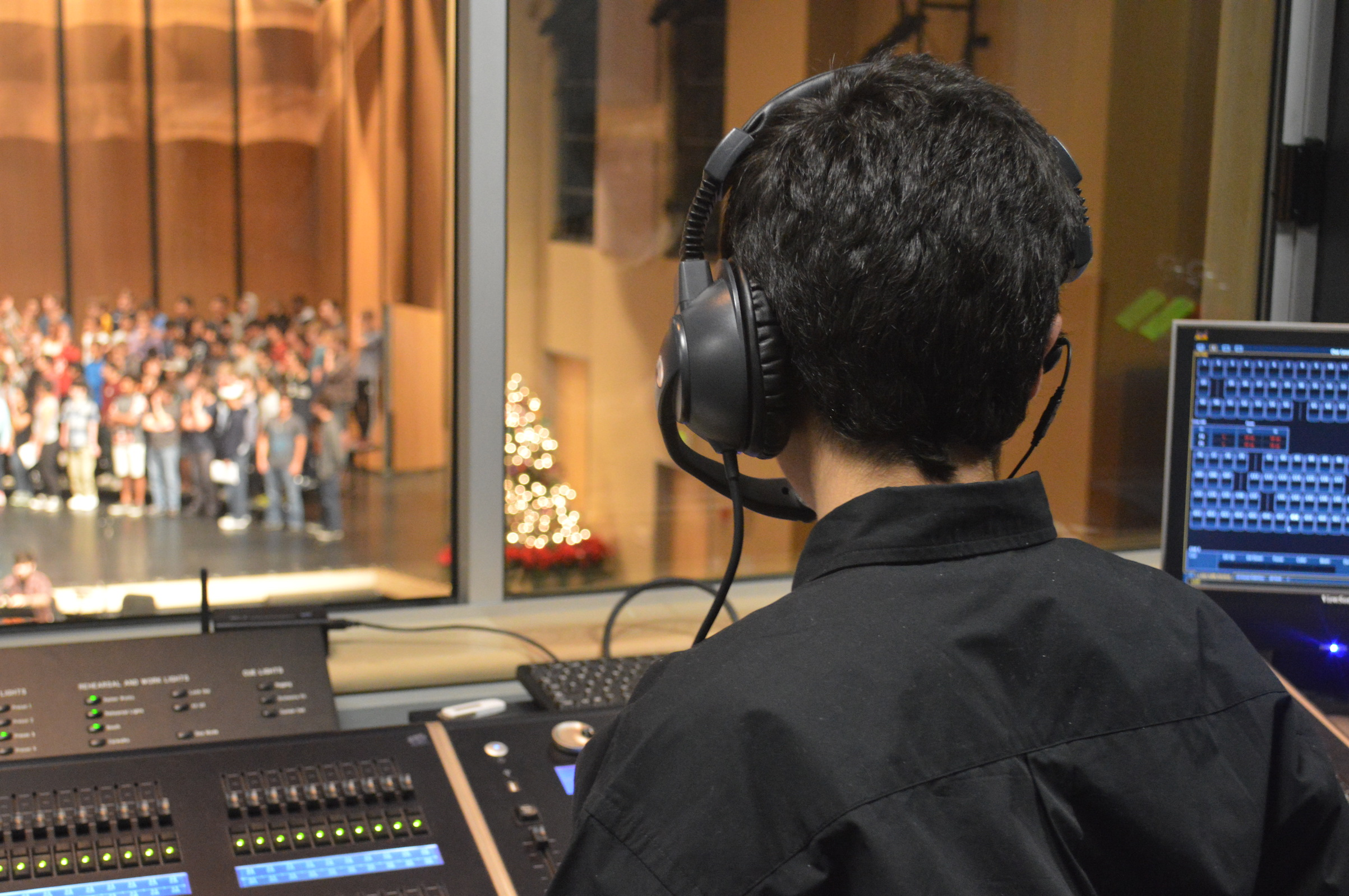 Freshman Andres Raddavero runs the light board during rehearsal for Carlmont's winter choir show. During this rehearsal, Raddavero learns his cues for the upcoming performances.