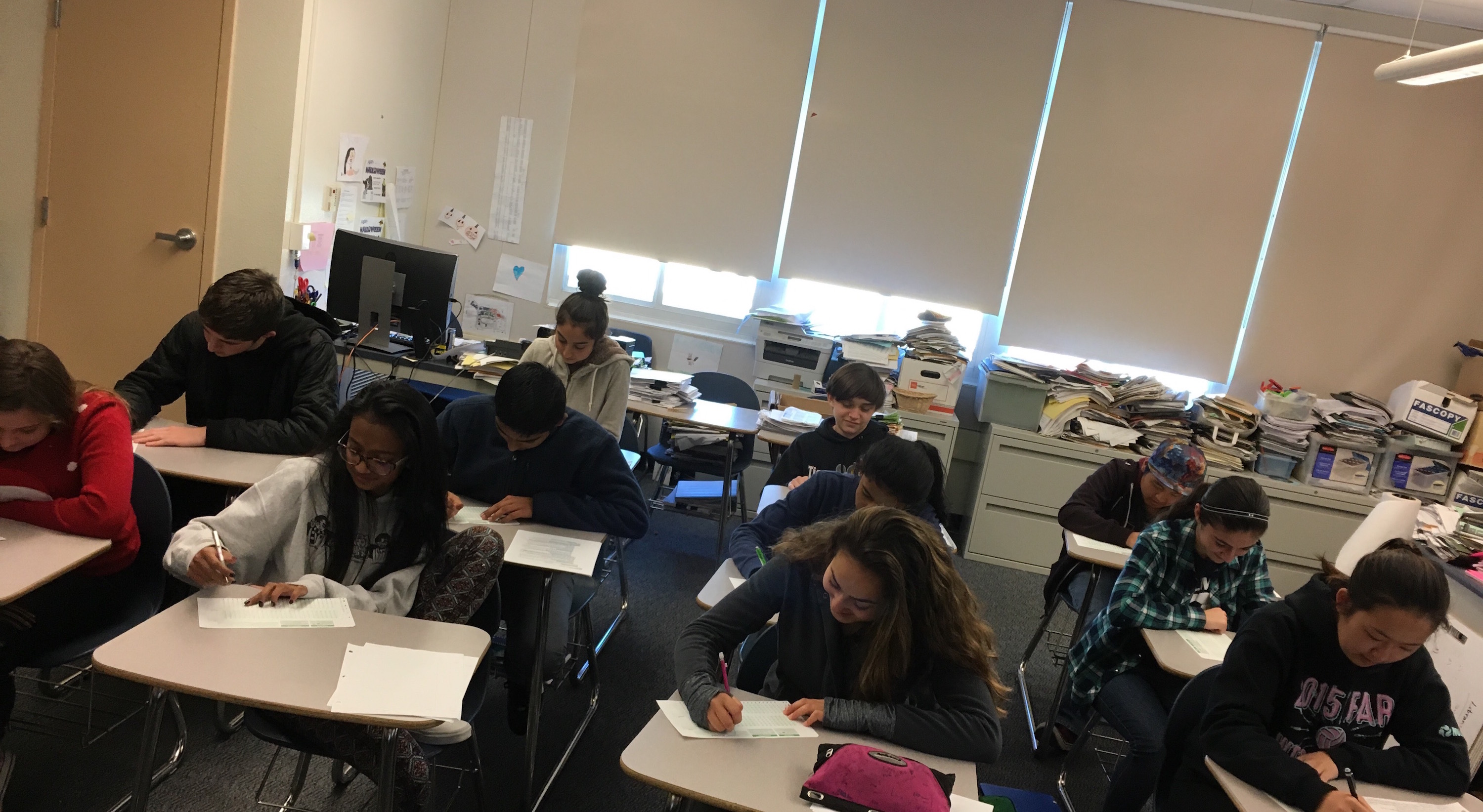 History students take a multiple-choice test. Each question on the test was its own decision, and each decision was influenced by its own factors.