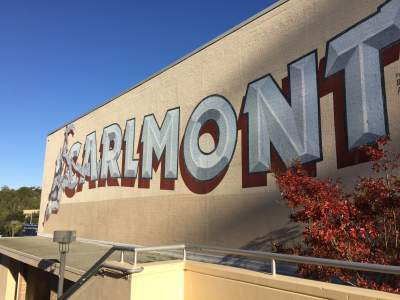 "On top of the school gym, the name ""Carlmont"" alongside its mascot, the Scot, reminds students of the community they belong to. Sophomore Nicole Turk says, ""To me, a school community is the camaraderie between all the students and faculty at Carlmont while we live in the moment."""