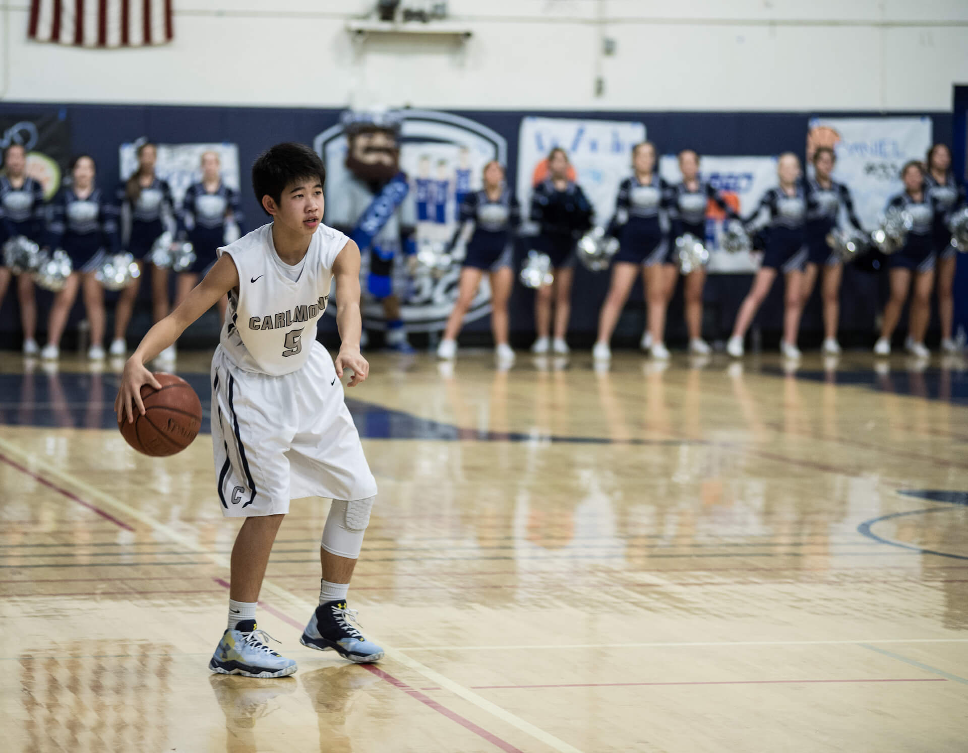 Sophomore point guard Sho Takahashi calls out a play in the first quarter as the Scots lead by seven.