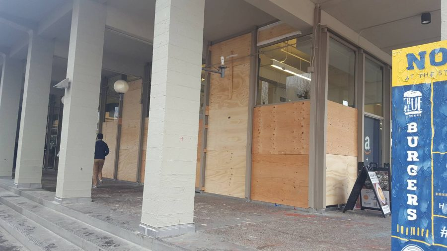 """Black bloc anarchists broke the glass windows of the MLK Jr. building during the protest on Feb. 2, and damaged other nearby properties. Many protestors argued that Milo Yiannopoulos would give """"hate speech"""" instead of """"free speech."""""""