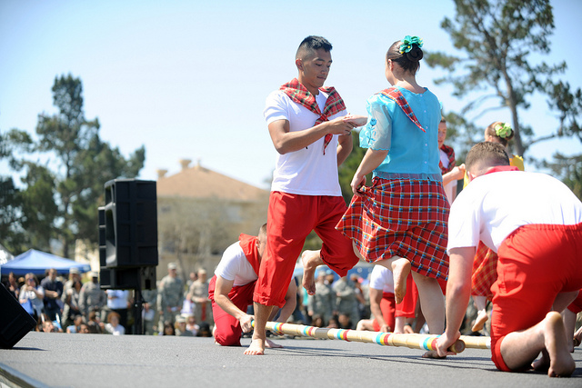 On+May+11%2C+2012%2C++the+local+community+of+Monterey+held+their+first+Language+Day+celebration.+A+man+and+a+woman+perform+the+traditional+tinikling+dance.
