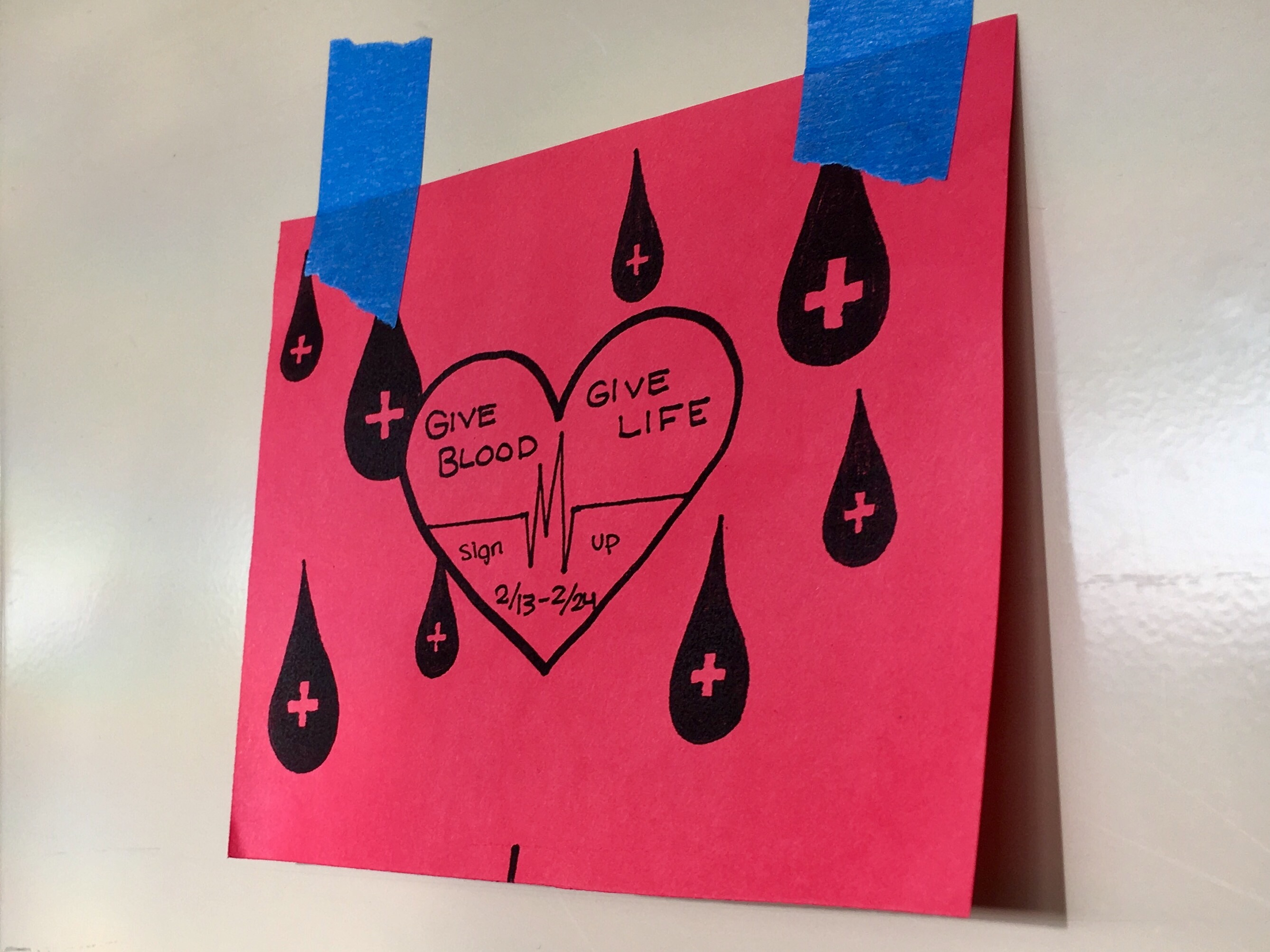 Quarter sheet flyers hang on lockers to remind students that sign ups for the blood drive are from Feb. 13 to Feb.24.