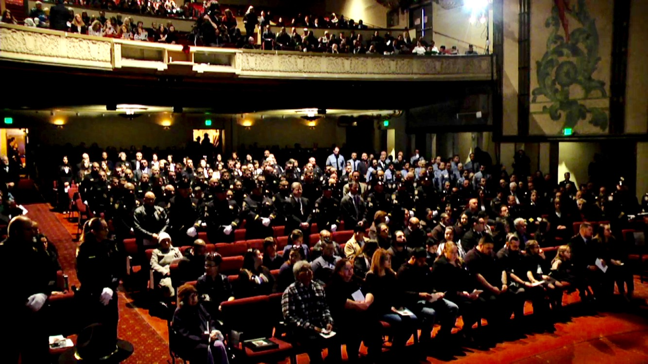 Family%2C+friends%2C+fellow+police+workers%2C+and++community+members+attend+the+memorial+service.+