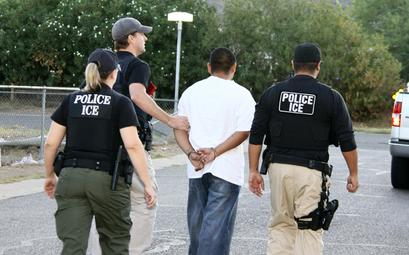 Immigration+and+Customs+Enforcement+officers+arrest+an+undocumented+immigrant+and+transfer+him+to+a+detention+facility+where+it+could+take+him+several+months+to+receive+a+bond+hearing.