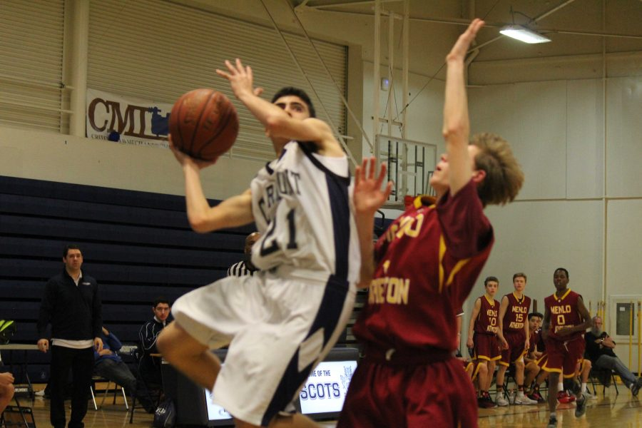 A+Carlmont+Scots++goes+up+for+a+layup+against+a+tough+Menlo-Atherton+defense.%0A