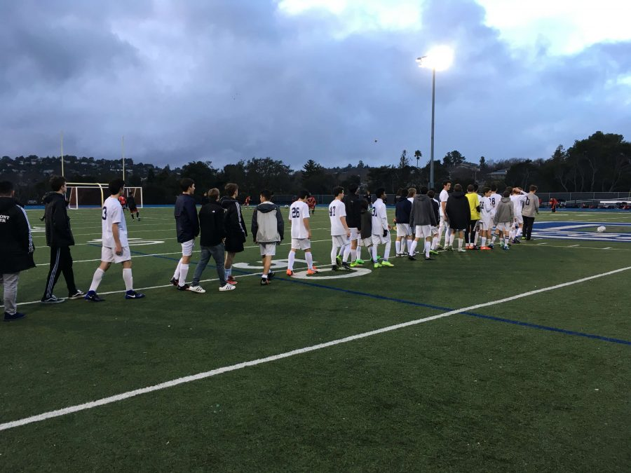 JV+Boys+Soccer+lines+up+to+shake+hands+with+Aragon+after+a+5-1+defeat.