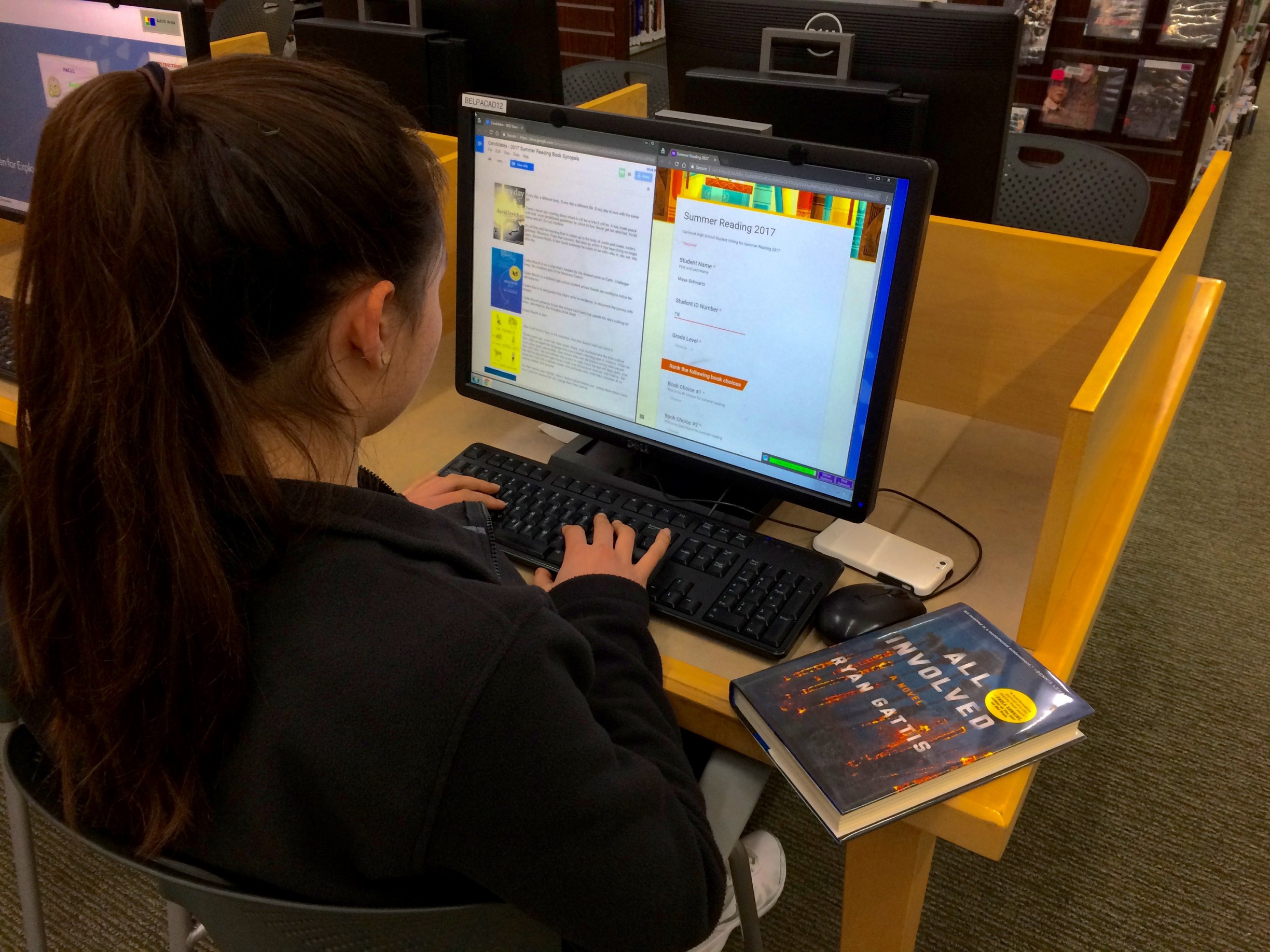 Sophomore Maya Schwartz looks at the candidates for the 2017 summer reading book and decides which ones to vote on.