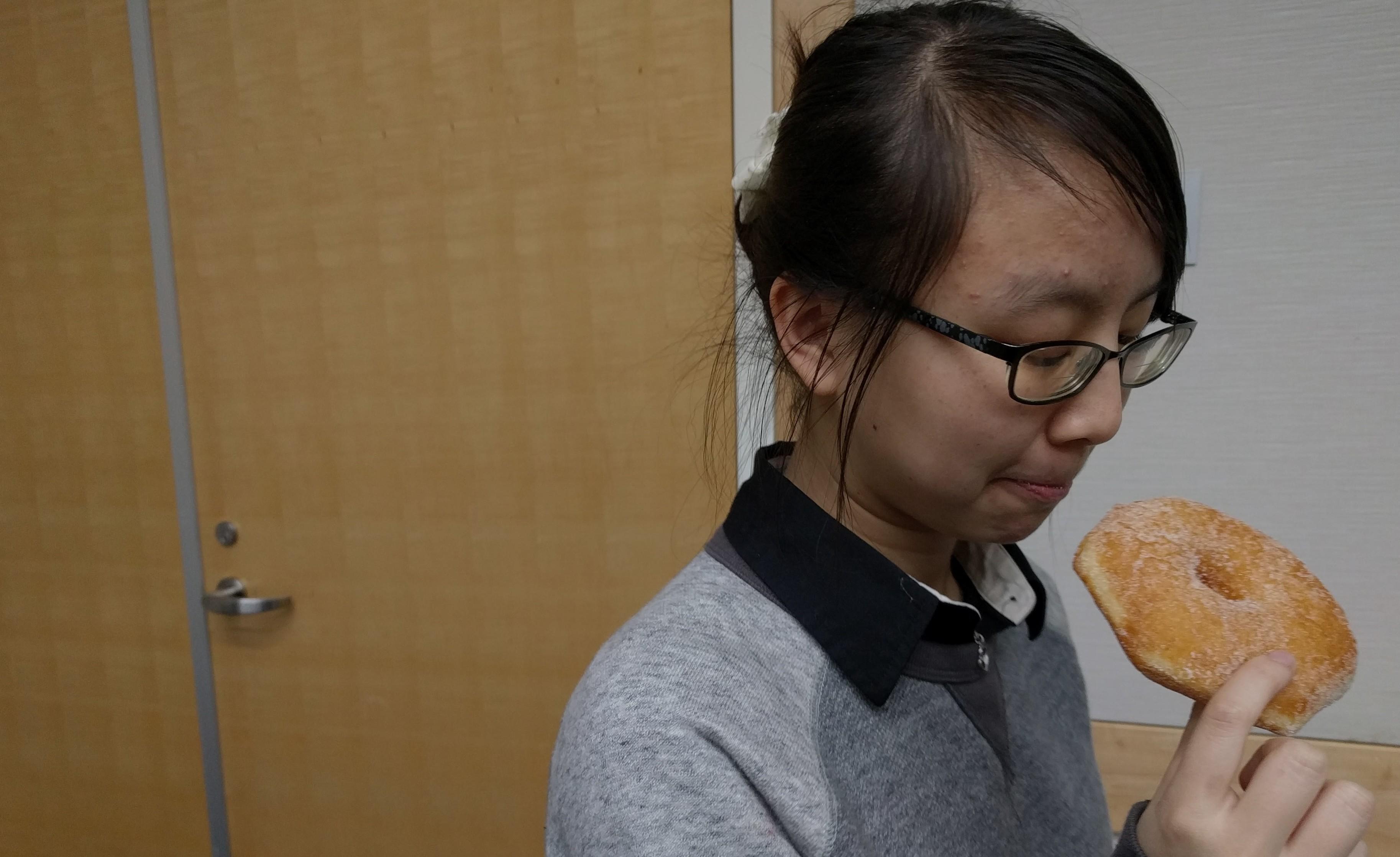 Jillian Yong, a senior, enjoys her donut from ASB.
