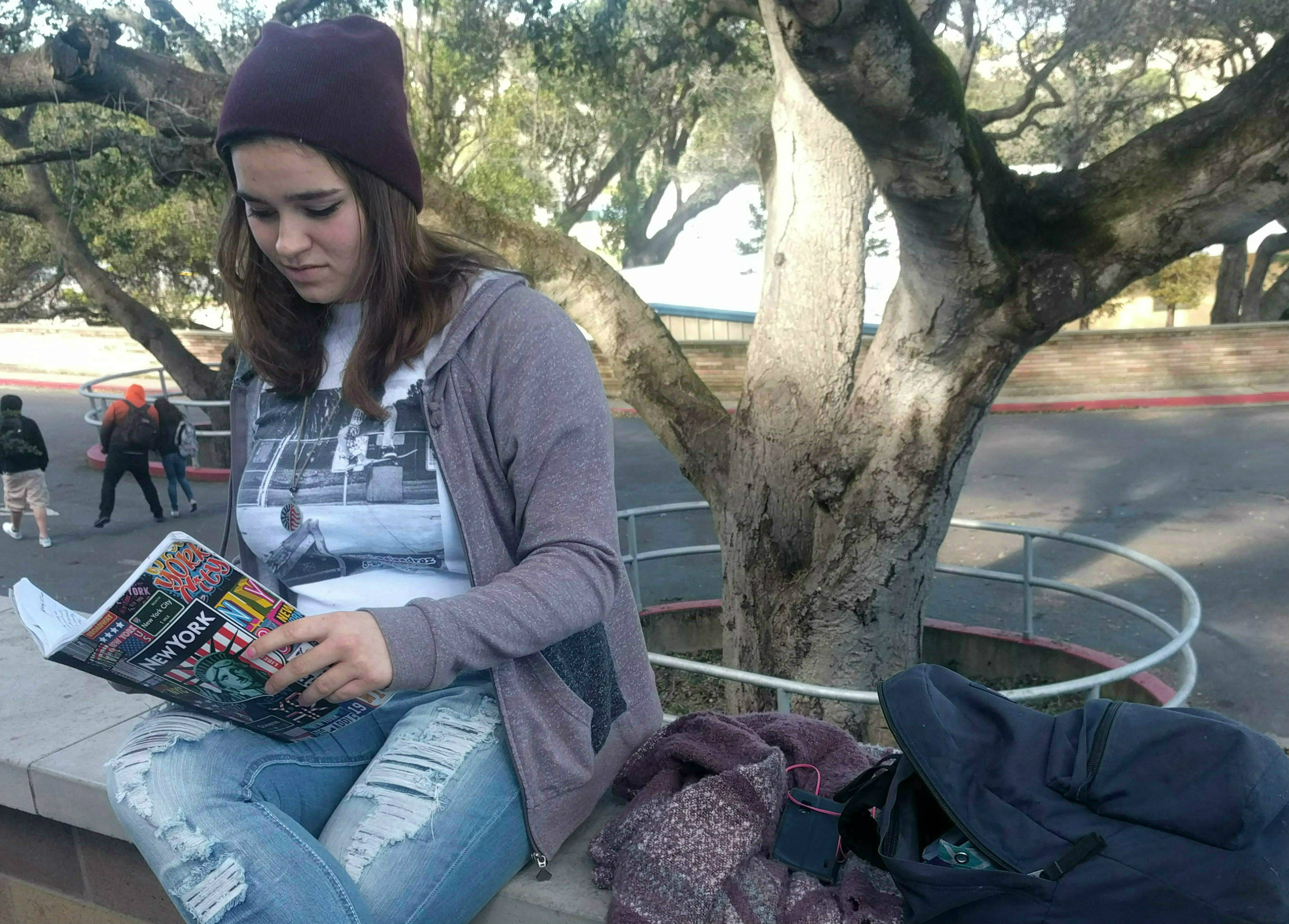 Savanna Rose Dillon sits and rereads her poetry she has written this past school year.