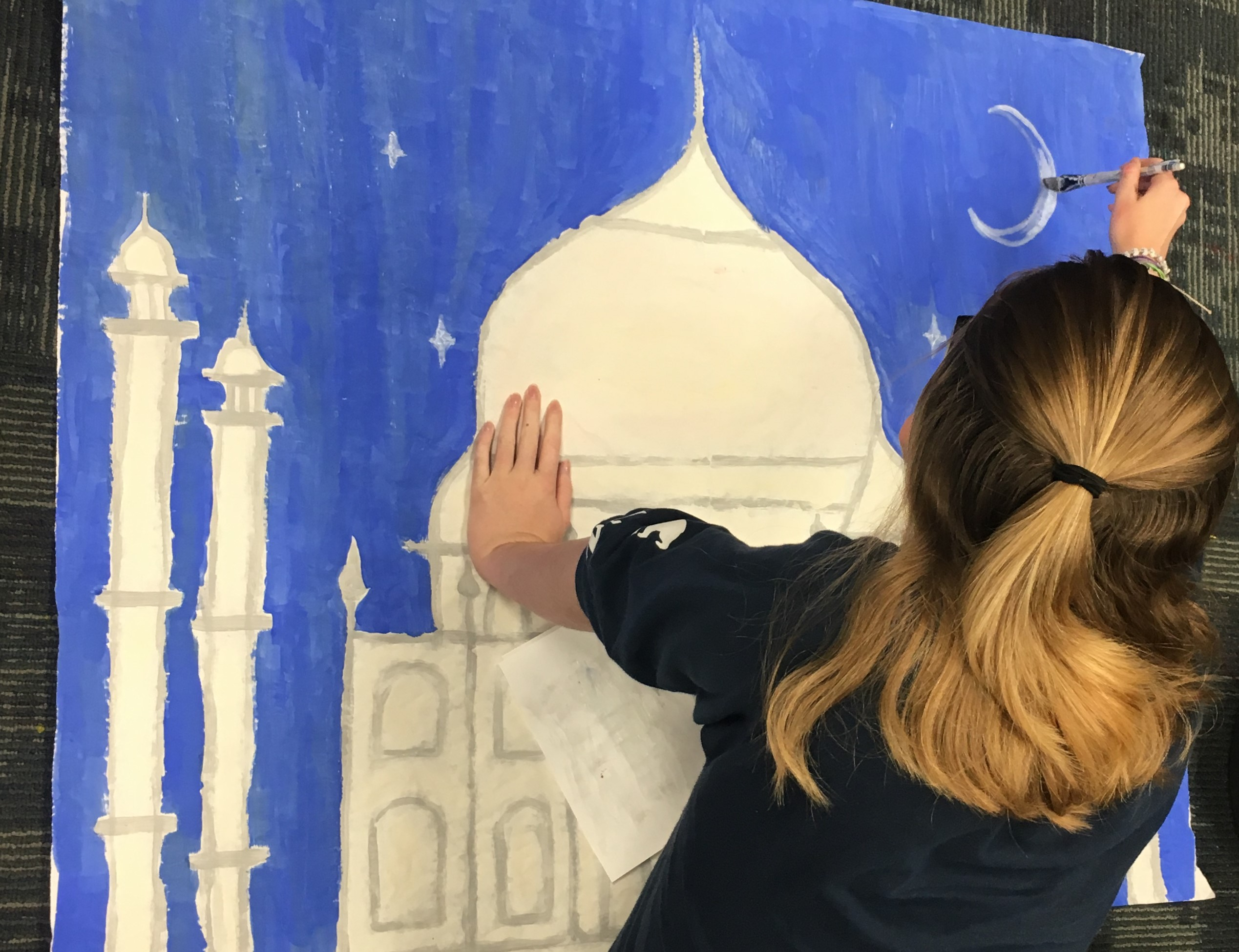 Olivia Smith, a senior, creates a piece for Heritage Fair two weeks before the assembly.