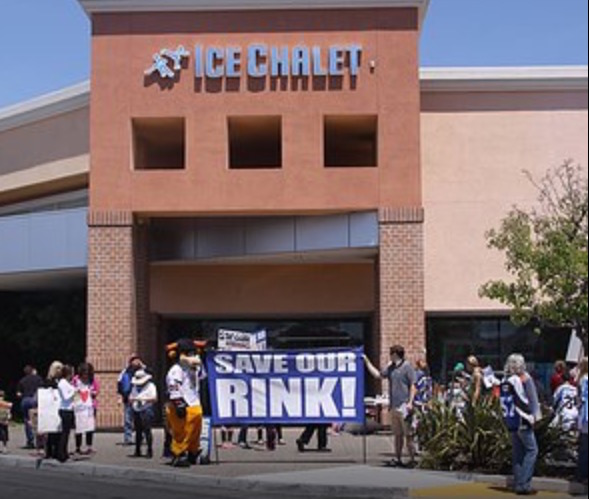 Protesters rally outside of the closed Ice Chalet, an ice skating rink in Bridgepointe Shopping Center.
