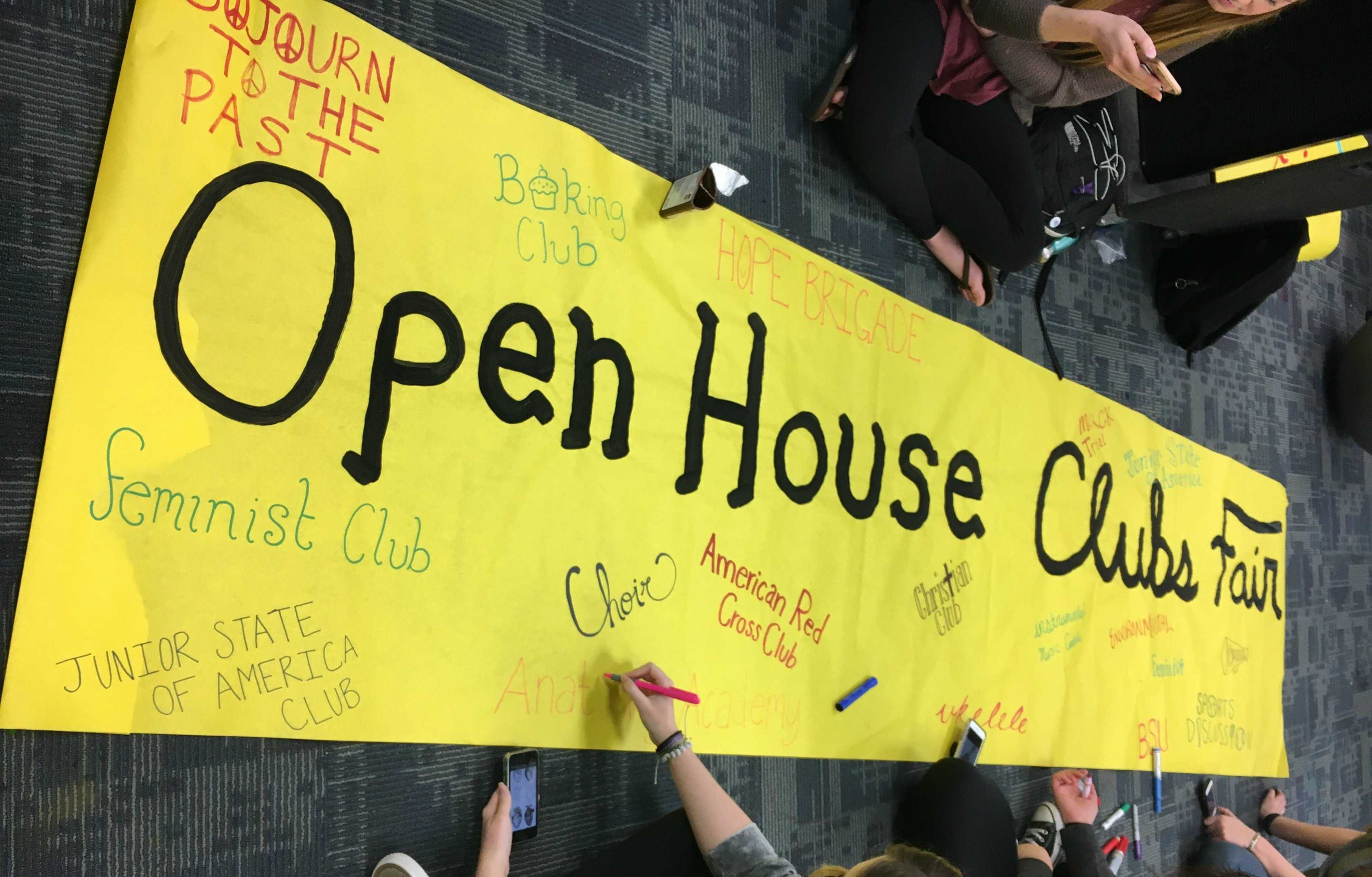 ASB Publicity Commission works on a poster to display at Open House's first Clubs Fair.