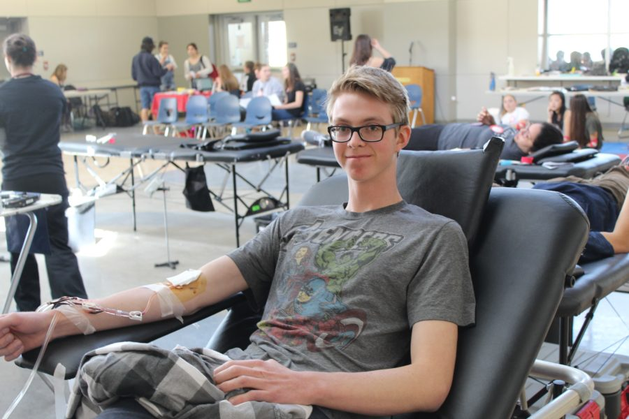 Chase+Nilsen%2C+a+senior%2C+donates+blood+during+lunch+on+March+9+during+the+recent+blood+drive.