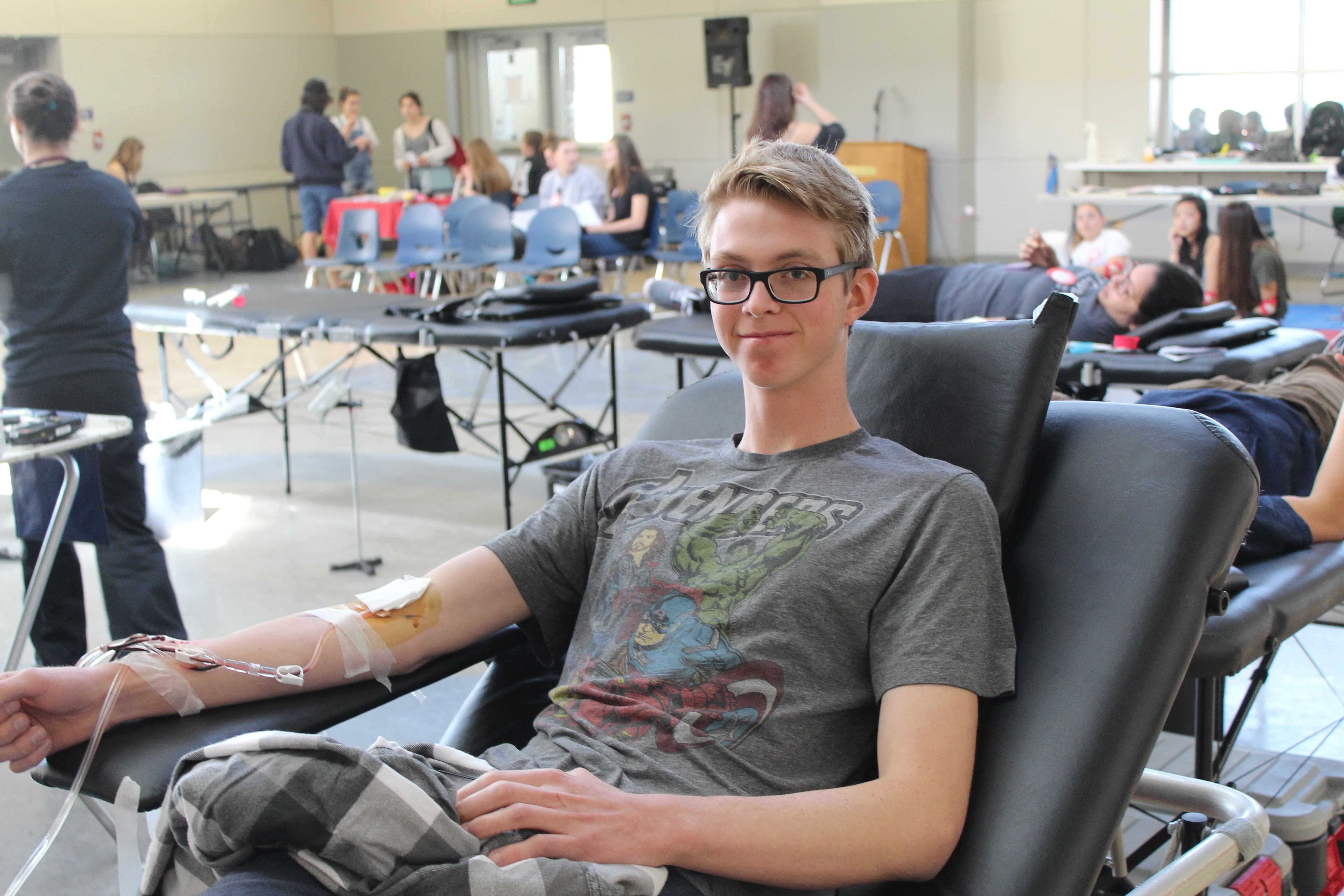 Chase Nilsen, a senior, donates blood during lunch on March 9 during the recent blood drive.