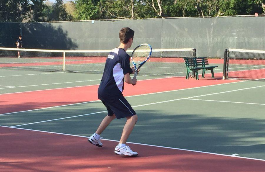 Doubles+player+Alexander+Kessler%2C+a+junior%2C+prepares+to+return+his+opponent%27s+serve.