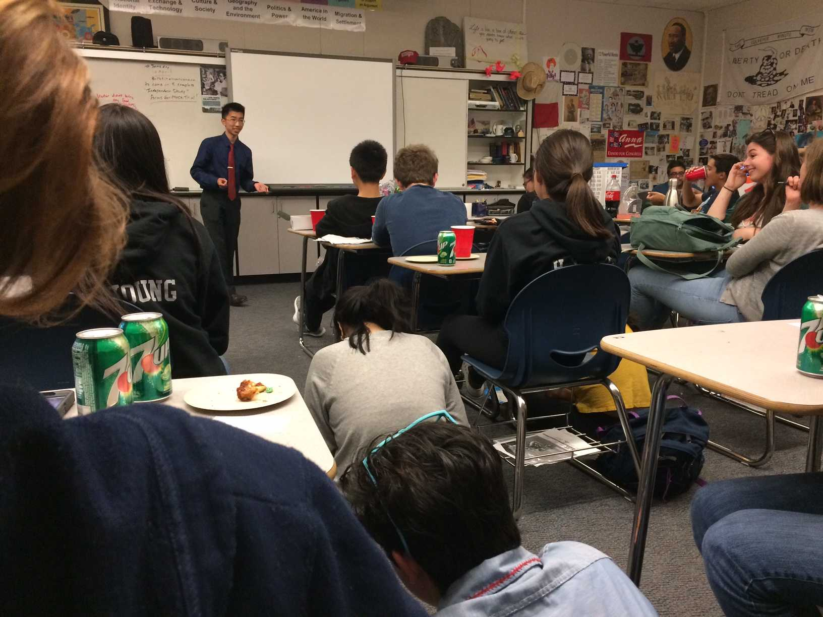 Justin Som, a junior running for club president, addresses Mock Trial during their final meeting in E2.