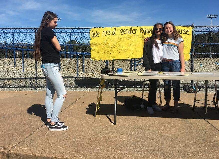 Human relations commissioners Lucy Perrone, Divya Menon, and Liz Boman ran the white board lunch time activity for gender equality week on March 8.