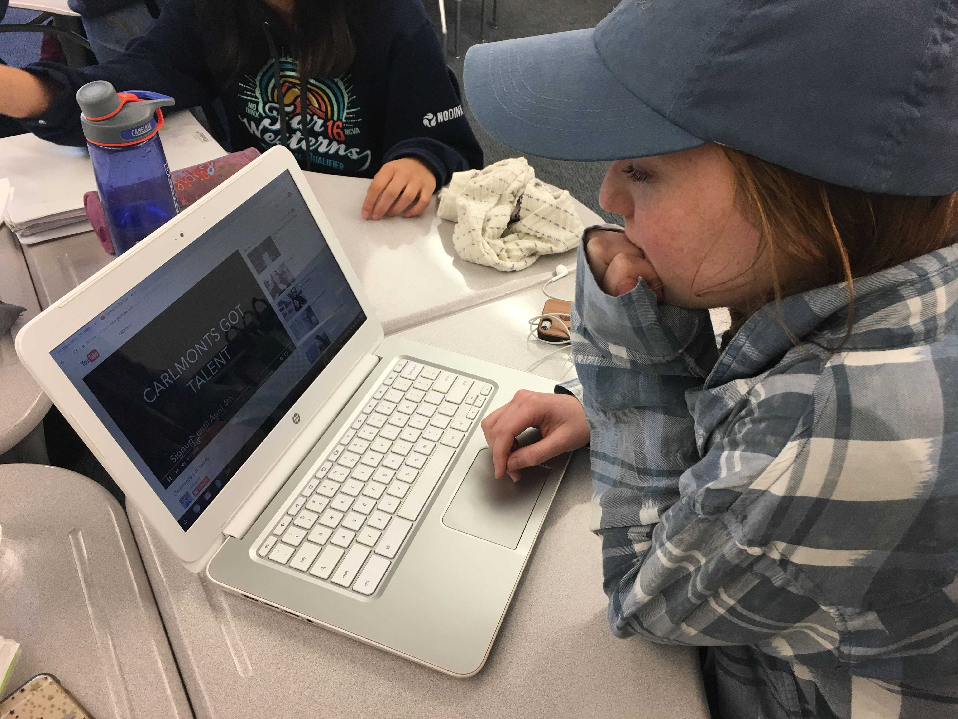 Elyse Geimer, a senior, watches a recent video about the upcoming event