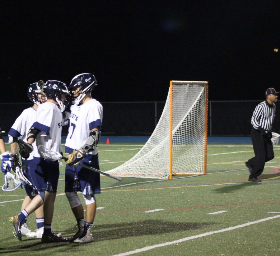 +Jack+Morris%2C+a+senior%2C+gets+congratulated+by+his+teammates+after+his+goal.+