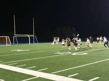 Strong performances fuel varsity girls lacrosse's victory