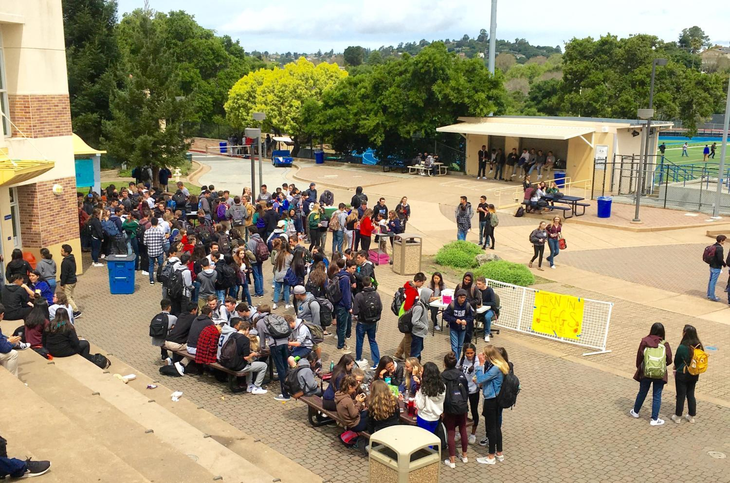 Students wait in a long line  in order to buy their prom ticket