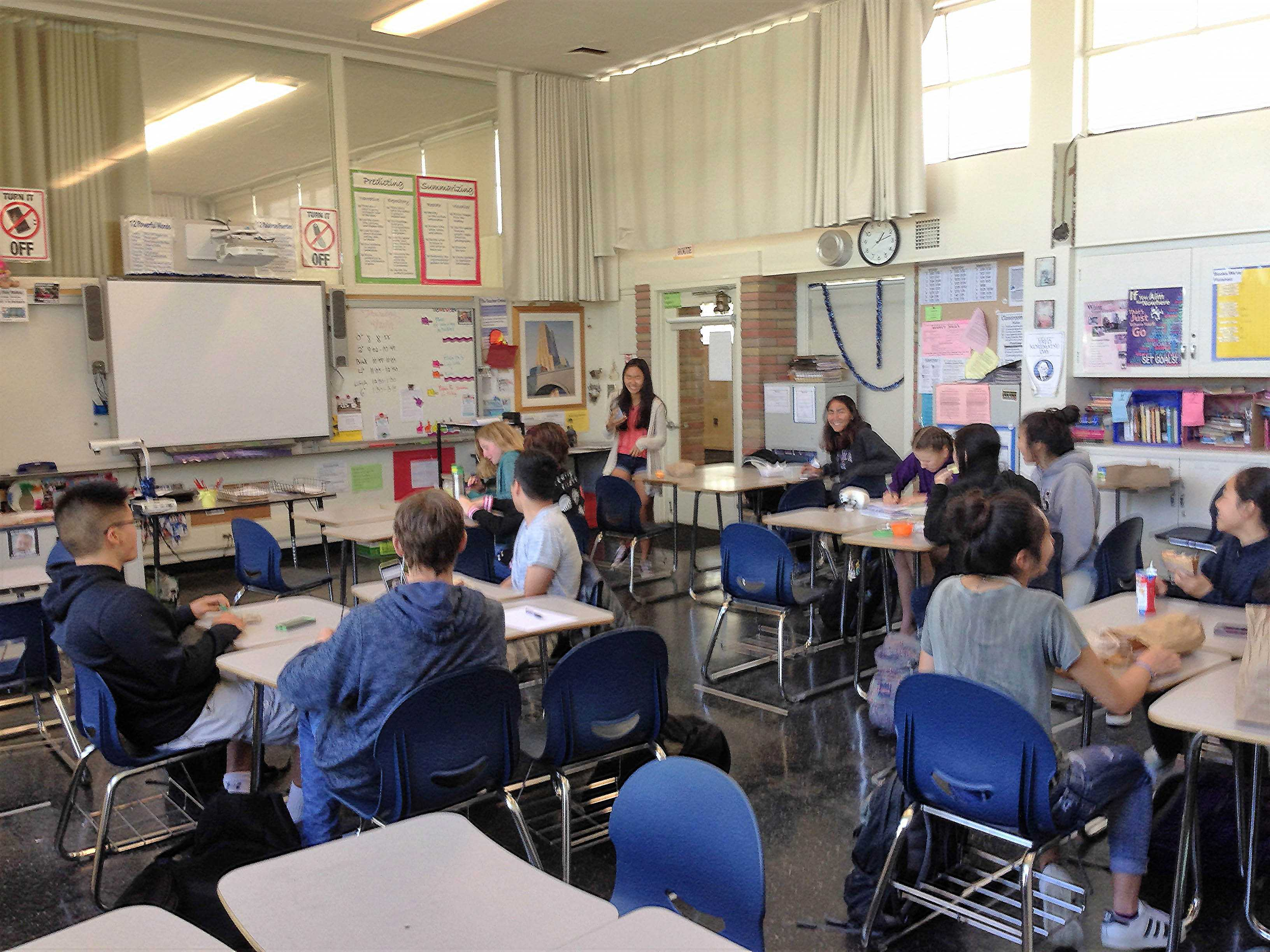 Cindy Ji leads a discussion, guided by the central question,
