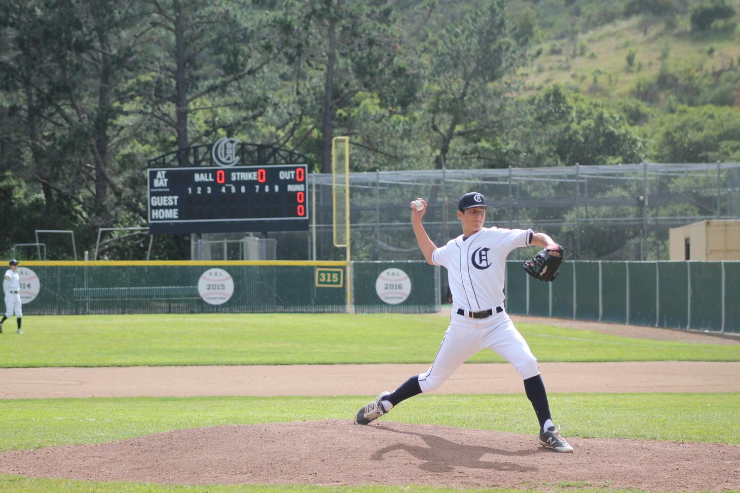 Sophomore David Bedrosian warms up on the mount before the game against Burlingame. Carlmont beat Burlingame 8-3 on April 26. Bedrosian would pitch for 5 innings and contribute to many of Carlmont's points with his hits.