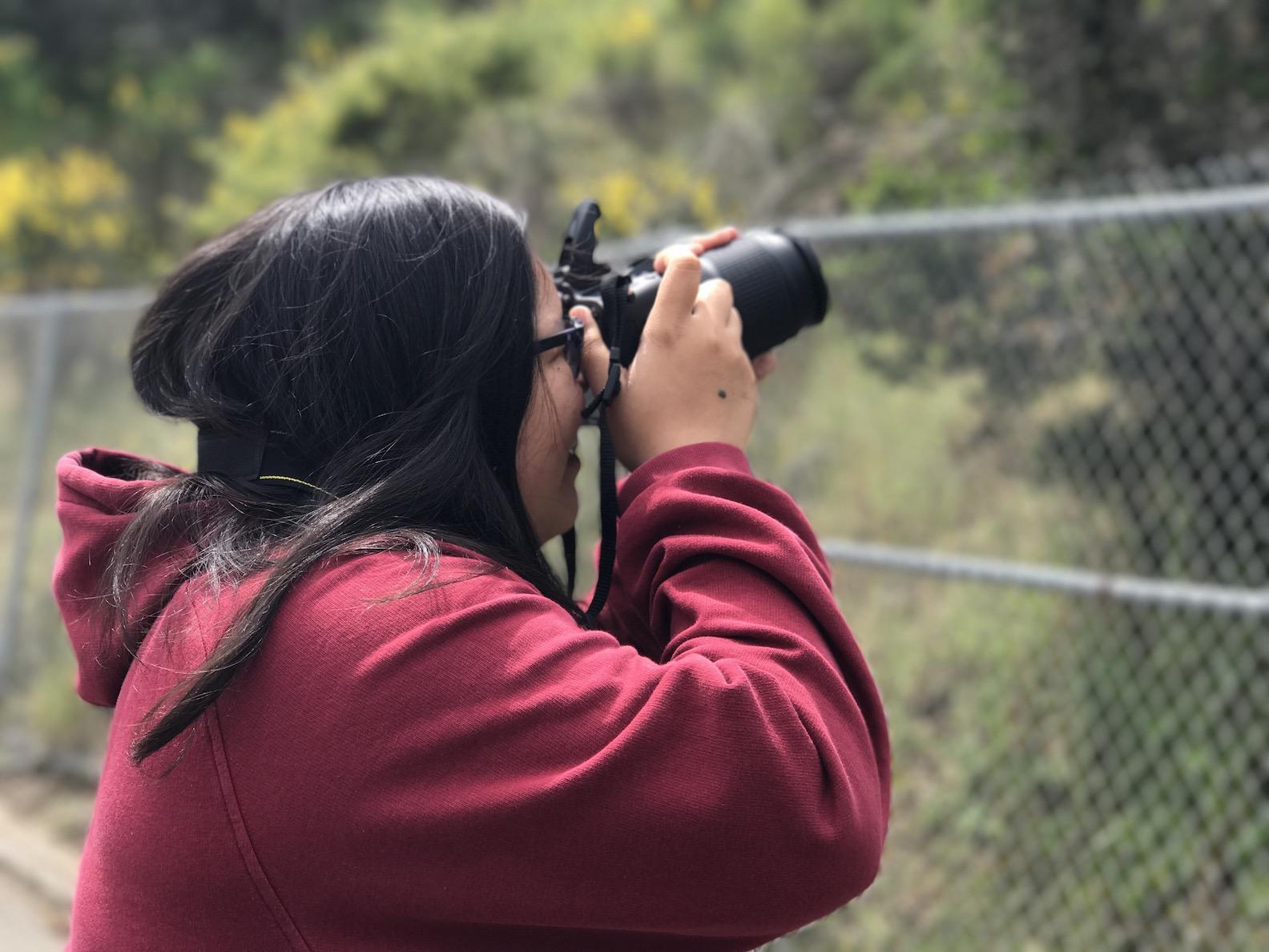 Akiko Balitactac takes her photo for the San Mateo County photography contest