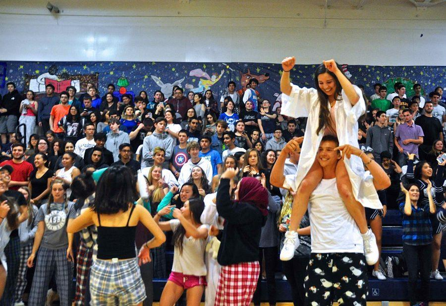 The+2016+Celebration+Assembly+brought+many+students+together+to+celebrate+their+past+year+at+Carlmont.+Class+of+2016+graduate%2C+Erin+Alonso%2C+hops+on+the+shoulders+of+her+friend+and+current+junior%2C+Jason+Lloyd%2C+to+celebrate+her+last+year+at+Carlmont.+