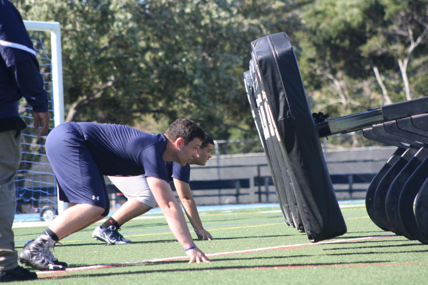 Varsity+football+players+practice+lineman+drills+after+school+on+May+25.