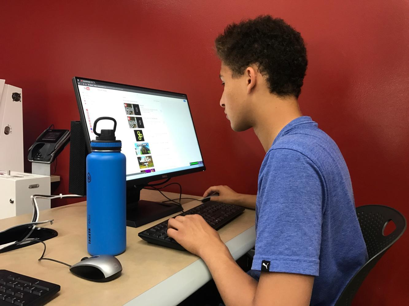 Ziad Kedkad, a sophomore, goes to the library in his free time after AP testing.