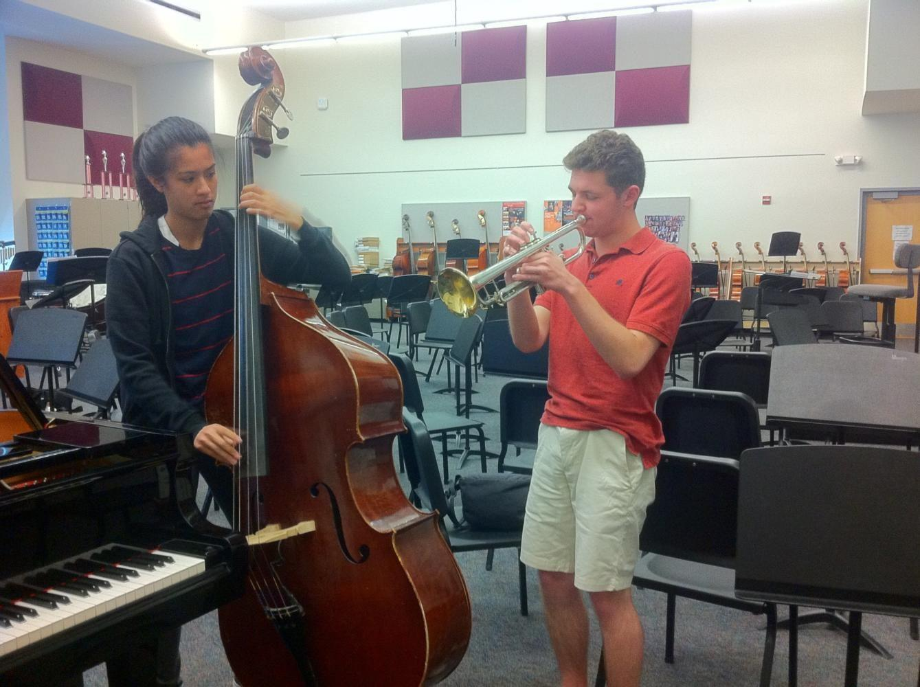 James+Dunning%2C+a+senior%2C+and+Jayla+Chee%2C+a+sophomore%2C+are+practicing+hard+for+the+upcoming+Spring+Concert.+They+will+be+playing+in+the+Jazz+Ensemble+on+Friday.+