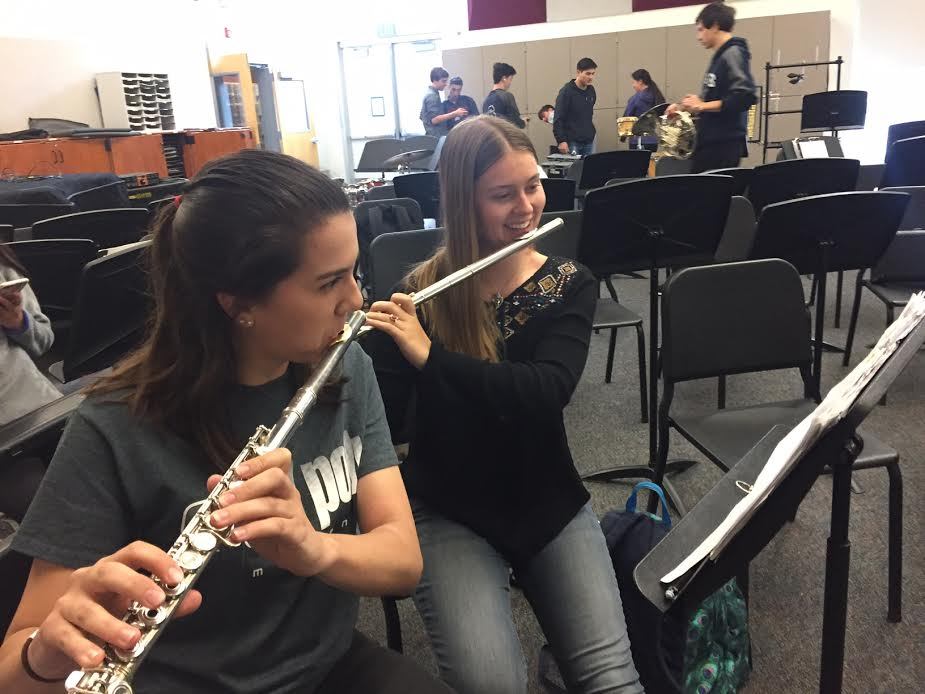 Seniors+Allison+Chavez+and+Hanna+Francis+play+their+flutes+in+preparation+for+their+last+Carlmont+performance.