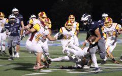 Varsity football continues historic 4-0 record