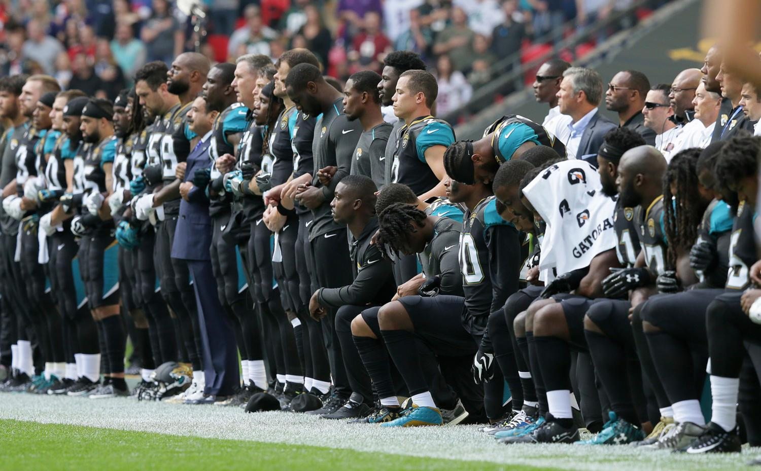 At a game versus the Ravens on September 24, Jaguars players choose during the National Anthem to either kneel, representing a peaceful protest, or stand with their arms linked, representing unity.