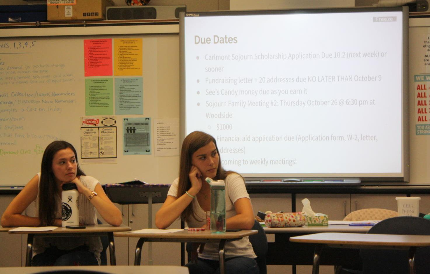 Twelfth-graders Jade Sebti and Sarah Tocatlian listen while other Sojourn members introduce themselves.