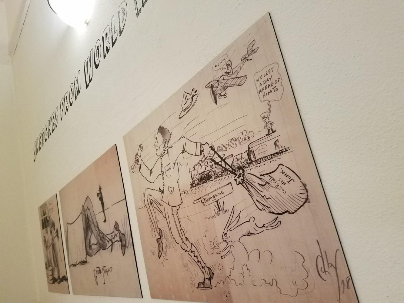 Various sketches hang from the rotunda walls depicting soldier Alvin Colby's daily life while deployed during World War One.