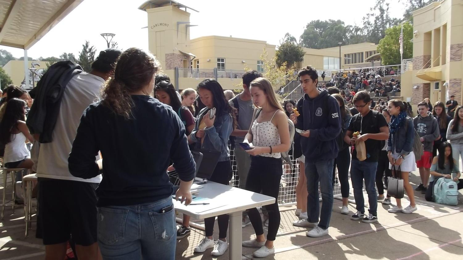 Carlmont students line up in the quad during the one-day homecoming ticket sale to buy their discounted tickets on Oct. 16. Tickets were sold for $5 cheaper than the normal prices on Oct. 17 to Oct. 27.
