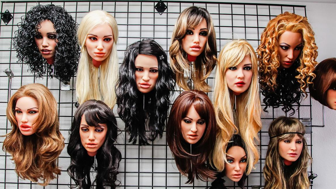 RealDoll heads, which will soon be transformed into full robots, on display in the showroom of Abyss Creations in San Marcos, California.