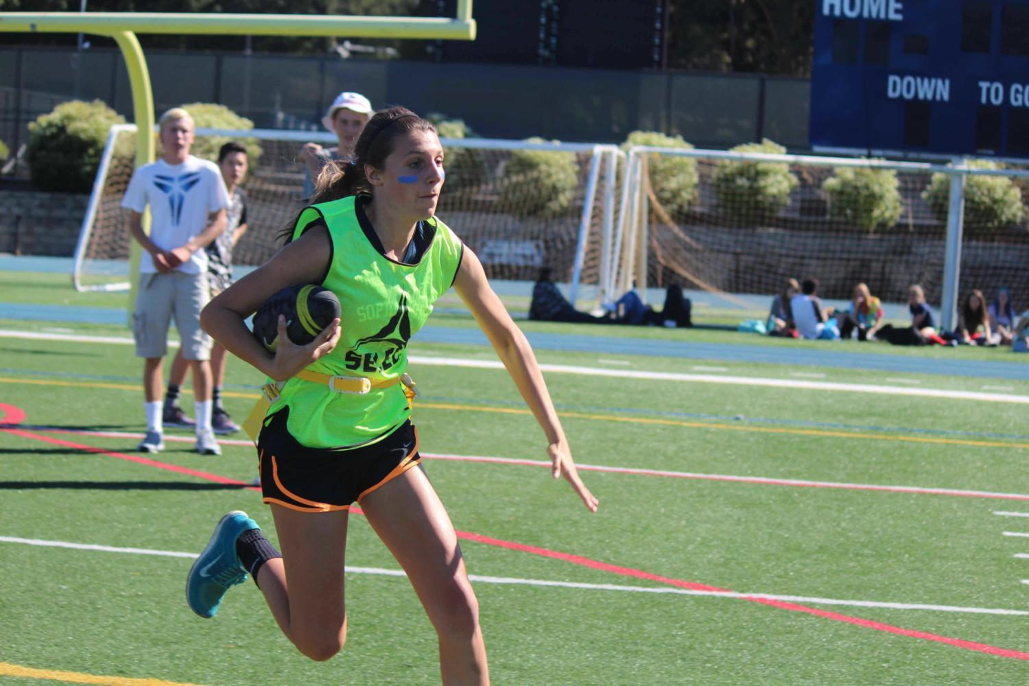 Emma Castro runs the ball down the field in one of last year's powder puff games. In previous years, powder puff took place at lunch during homecoming week.
